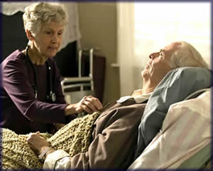 Hospice Nurse comforting a terminally ill patient